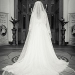 Real Bride Genevieve wears Fleur by Naomi Neoh - Bride walking in to church