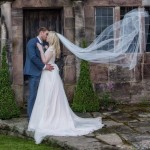 Real Bride Natalie wears Fleur by Naomi Neoh - Veil blowing image