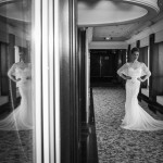 Real Bride Laura wears Elsa by Eliza Jane Howell - Black & White hallway