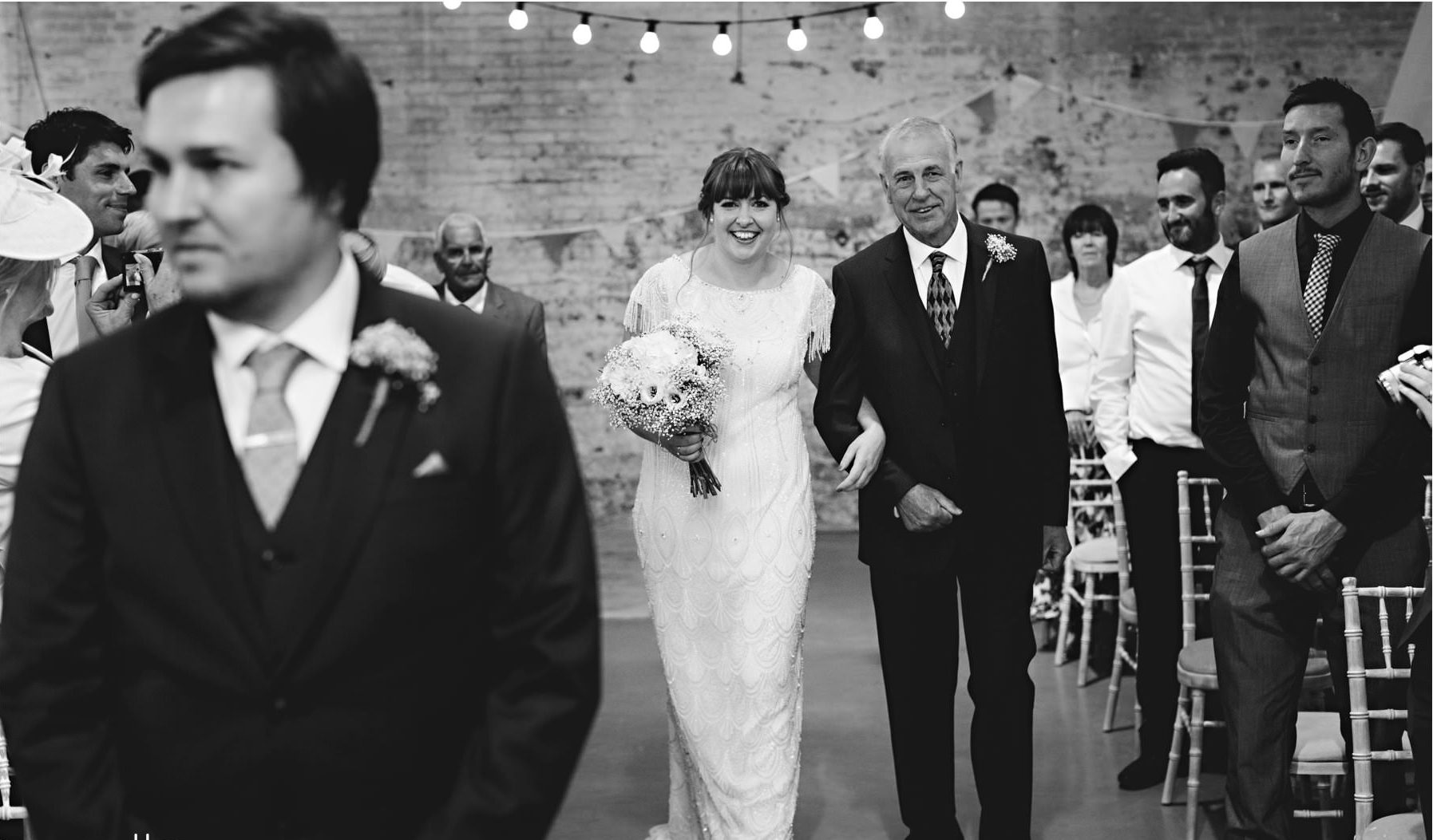 Real Bride Amy wears Fleur by Eliza Jane Howell - Bride walking in