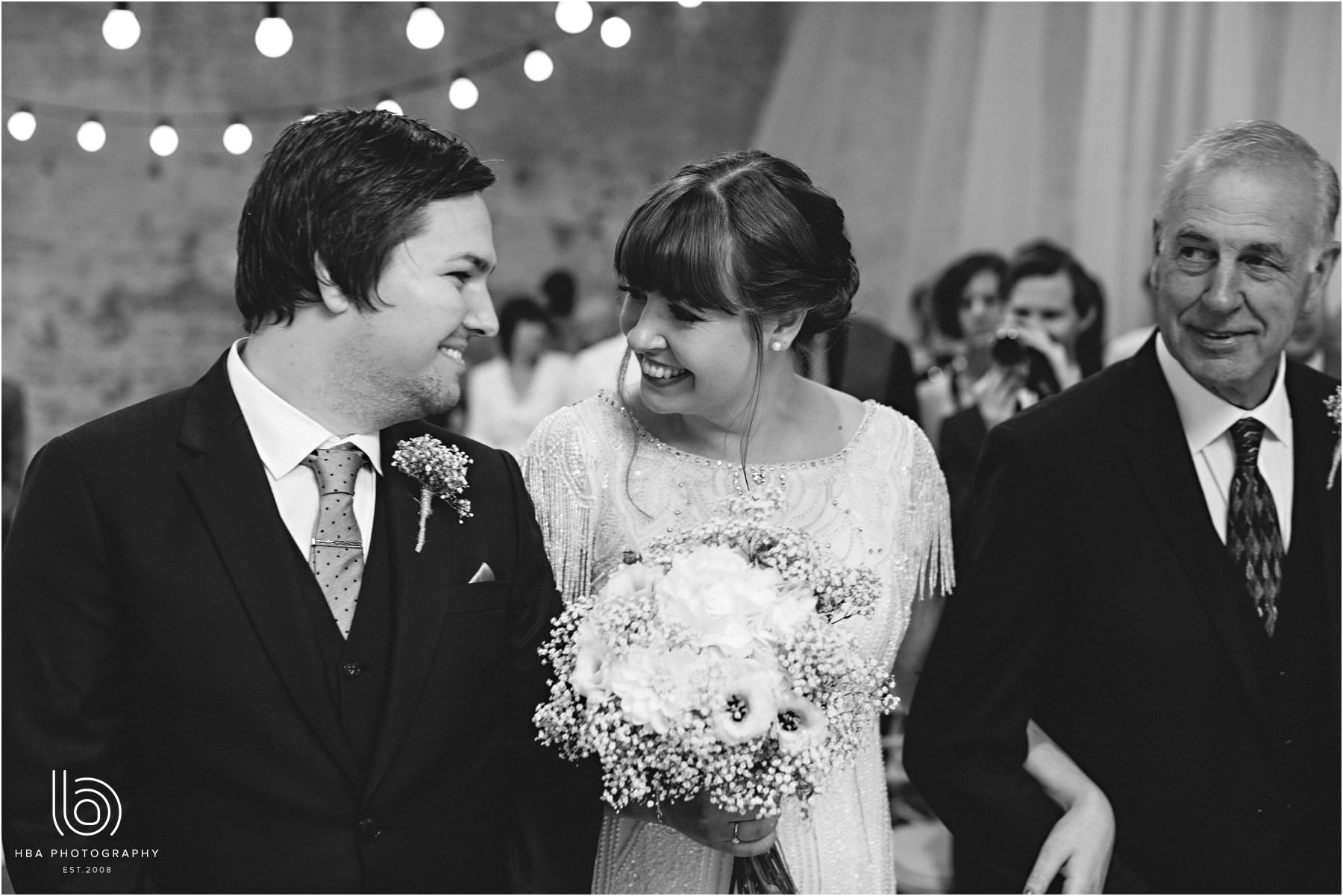 Real Bride Amy wears Fleur by Eliza Jane Howell - Bride & Groom at the alter