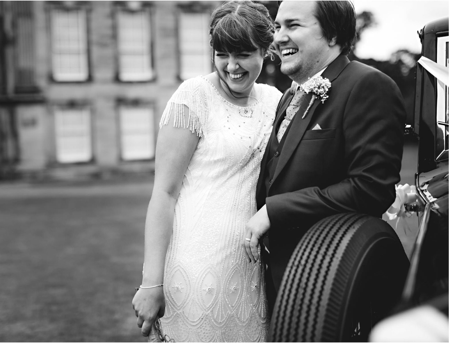 Real Bride Amy wears Fleur by Eliza Jane Howell - Bride & Groom by Car B & W Image