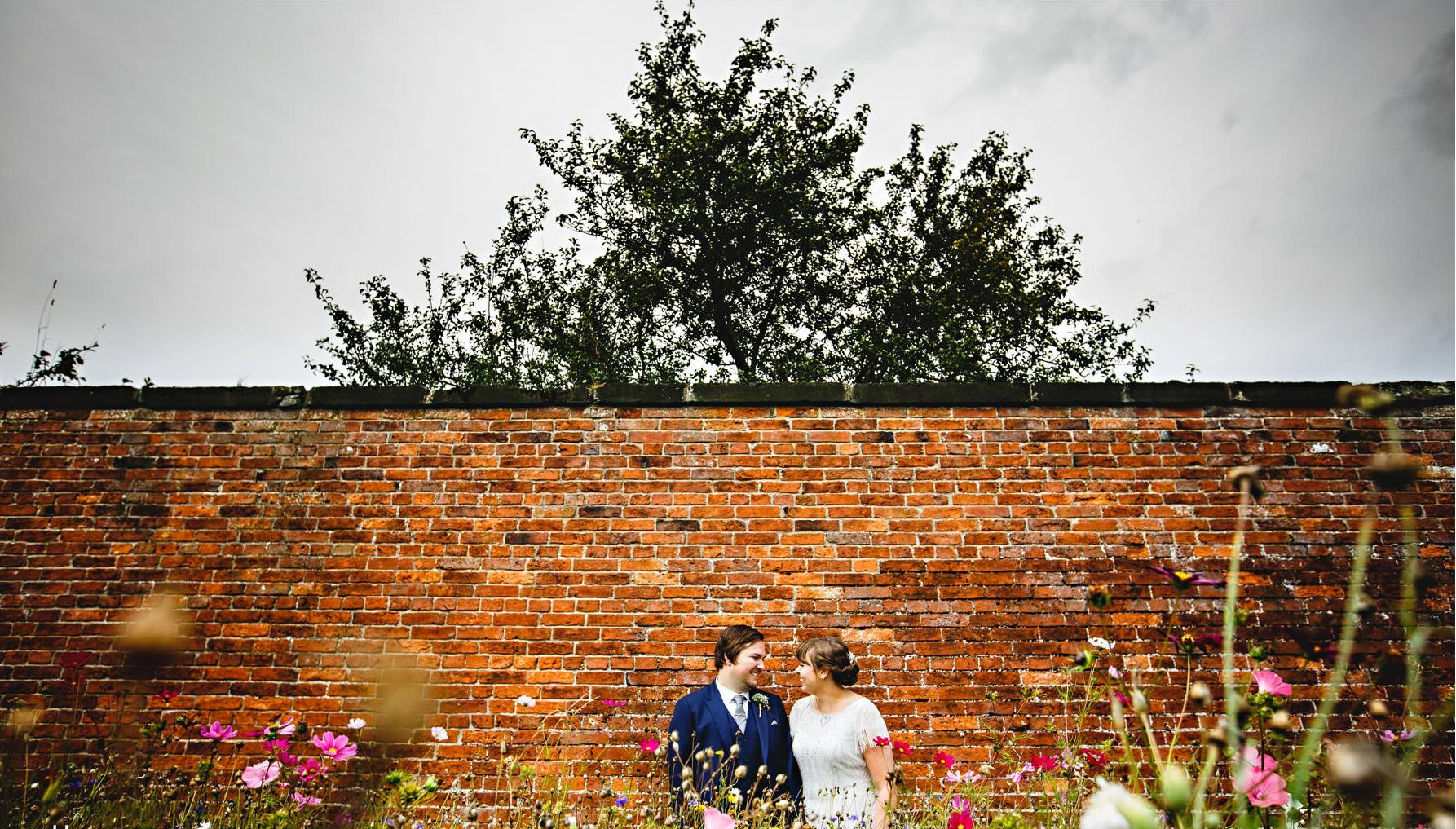 Real Bride Amy wears Fleur by Eliza Jane Howell - Bride & Groom in the walled garden