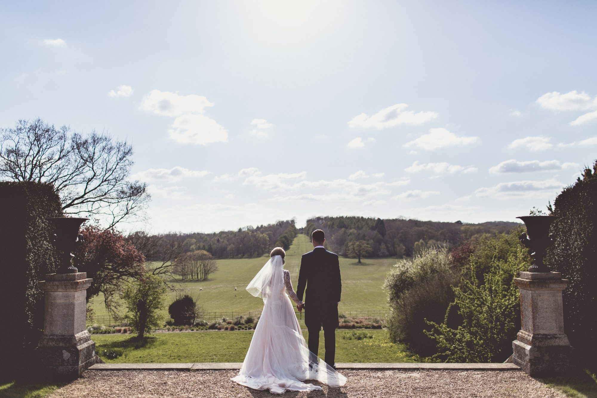 Real Bride Naomi wears Fleur by Naomi Neoh - Bride & Groom looking out to the landscape