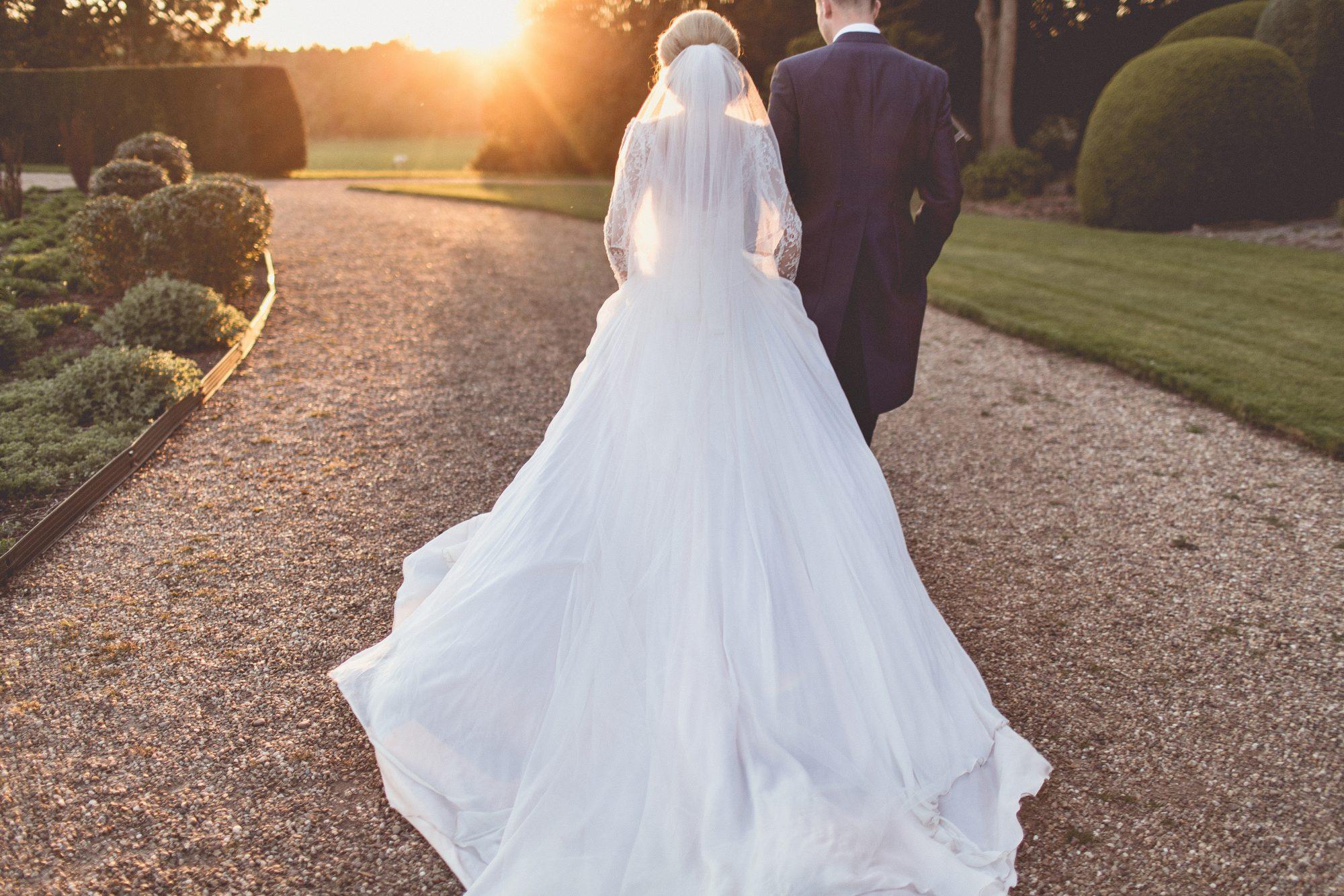 Real Bride Naomi wears Fleur by Naomi Neoh - Bride & Groom Sunset Walk