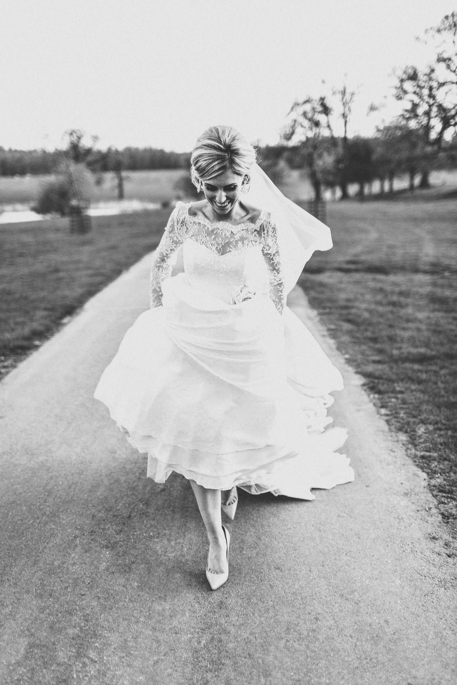 Real Bride Naomi wears Fleur by Naomi Neoh - Bride walking - Black & White
