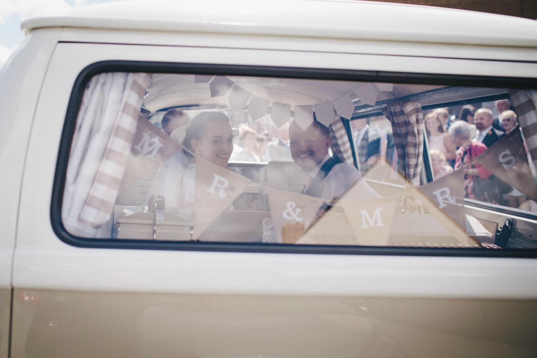 Real Bride Olivia in Jesus Peiro Dress 6002 -Bride & Groom inside campervan