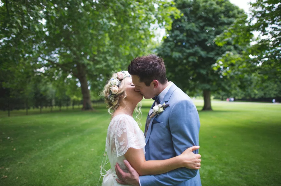 Real Bride Rebecca wears Charlie Brear 1950.7 - Bride & Groom Kissing- Cicily Bridal Leicester