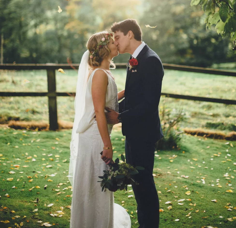 Real Bride Lucy wears Charlie Brear 1920.2 - Bride & Groom Kissing - Cicily Bridal Leicestershire