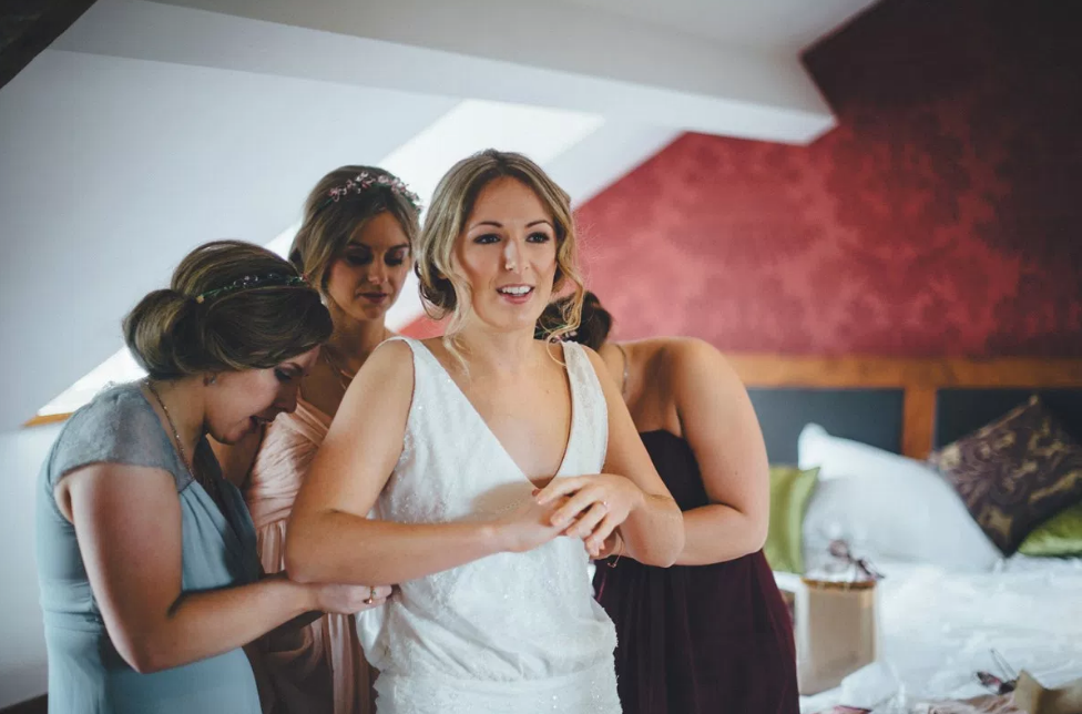 Real Bride Lucy wears Charlie Brear 1920.2 - Bride getting dressed - Cicily Bridal Leicestershire