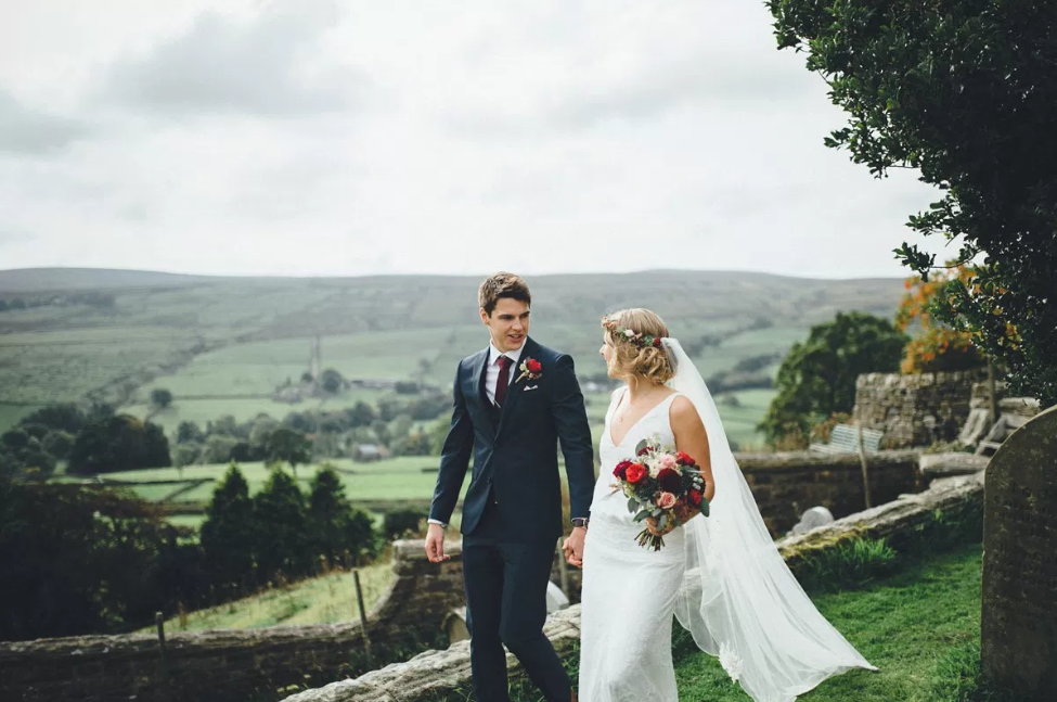 Real Bride Lucy wears Charlie Brear 1920.2 -Bride & Groom Walking - Cicily Bridal Leicestershire