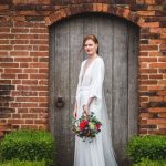 Real bride wearing Charlie Brear Nyika wedding dress from Cicily Bridal